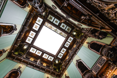 SINAIA, ROMANIA - AUGUST 20, 2014: The interior of Neo-Renaissance Peles palace castle in Carpathian mountains, built between 1873 and 1914 for King Carol I. The Hall of Honour movable glass ceiling Editorial