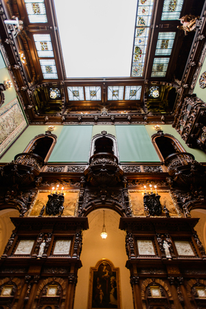 SINAIA, ROMANIA - AUGUST 20, 2014: The interior of Neo-Renaissance Peles palace castle in Carpathian mountains, built between 1873 and 1914 for King Carol I. The Hall of Honour movable glass ceiling Redakční