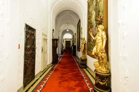 SINAIA, ROMANIA - AUGUST 20, 2014: The interior of beautiful Neo-Renaissance Peles palace castle in Carpathian mountains, built between 1873 and 1914 for King Carol I. Passage with elevator door on the left