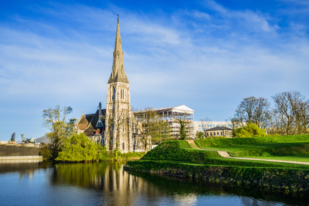 Back view of St Albans Church near Kastellet fortress defence moat filled with water in Copenhagen, Denmark Stock Photo