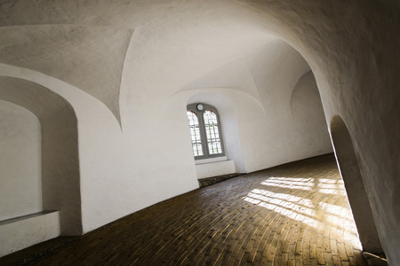 COPENHAGEN, DENMARK - MAY 03, 2018: Interior of Rundetaarn Round Tower equestrian staircase, filled with sunset light