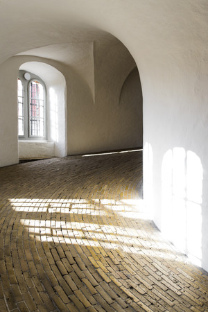 COPENHAGEN, DENMARK - MAY 03, 2018: Interior of Rundetaarn Round Tower equestrian staircase, filled with sunset light