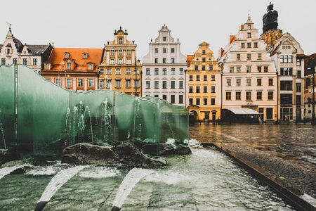 Colourful houses, glass fountain, Market Square, Wroclaw, Poland