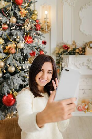 girl making video call, streaming, blogging on christmas Stok Fotoğraf - 132234164