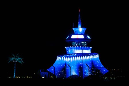 BATUMI, GEORGIA - August 22, 2012: Nightview of illuminated hi-tech modern building unique wave shape Control tower of Batumi Airport, built in 2011 by Michele De Lucchi team - Alberto Bianchi (project leader), Alessandro Ghiringhel (architect)
