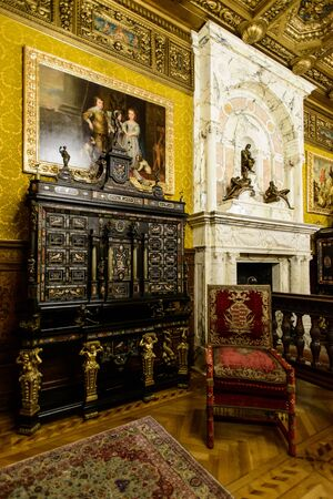 SINAIA, ROMANIA - AUGUST 20, 2014: The interior of Neo-Renaissance Peles palace castle in Carpathian mountains, built between 1873 and 1914 for King Carol I. Interior details Editorial