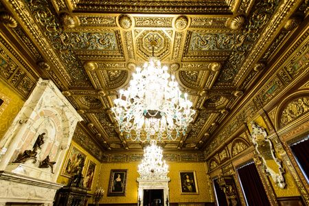 SINAIA, ROMANIA - AUGUST 20, 2014: The interior of beautiful Neo-Renaissance Peles palace castle in Carpathian mountains, built between 1873 and 1914 for King Carol I. The Florentine Room ceiling