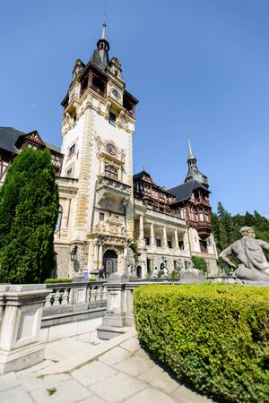 SINAIA, ROMANIA - AUGUST 20, 2014: The exterior details of beautiful Neo-Renaissance Peles palace castle in Carpathian mountains, built between 1873 and 1914 for King Carol I. Terraces decorated with statues Editorial