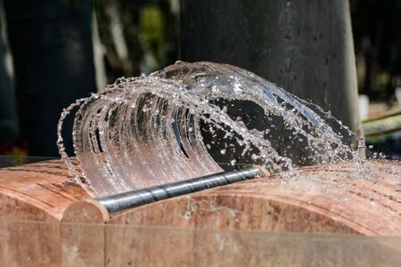 Istanbul, Turkey - August 22, 2014: The marble book fountain in the Gulhane park with the jet of water in the form of page