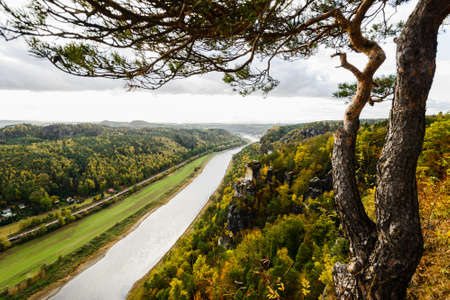 Picturesque autumn sunset scenery of Elbe river from Bastei bridge and Sandstone mountains, Saxon Switzerland National Park near Dresden, Germany