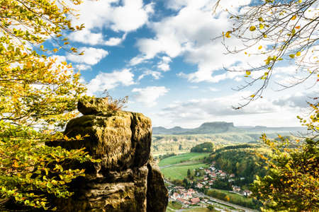 Picturesque autumn scenery of Rathen town and Elbe river from Bastei bridge and Sandstone mountains, Saxon Switzerland National Park near Dresden, Germany