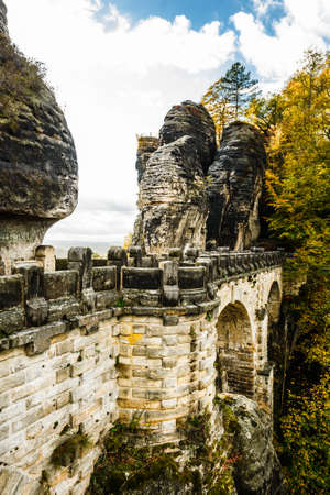 Picturesque autumn scenery of Bastei bridge and Elbe Sandstone mountains, Saxon Switzerland National Park near Dresden, Germany