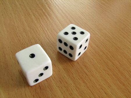luckiness: White dice on the table Stock Photo