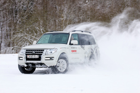 mud and snow: MINSK, BELARUS - MARCH 02, 2016: New Mitsubishi Pajero IV at the test drive event for automotive journalists from Minsk Editorial