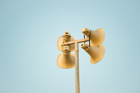 Loudspeaker against the sky clouds out side
