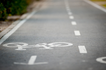 tarmac: Asphalt road texture with two line and bicycle sign. shallow depth of field