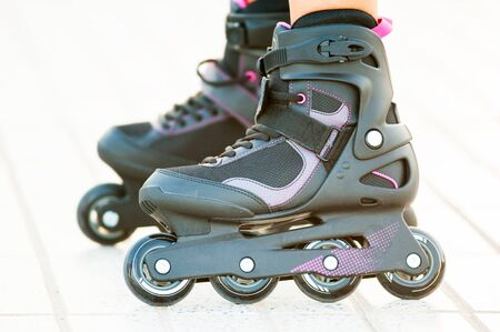 roller blade: Close-up view of girls legs in roller blades