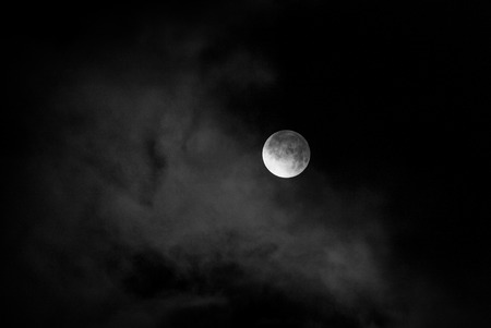 planetarium: moon in night skies covered by the cloud. Monochrome Stock Photo