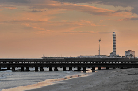 lighthouse and pier on sunset view