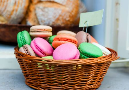 colorful macaroon cookies in basket closeup