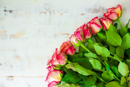 bouquet of roses on a wooden background 写真素材