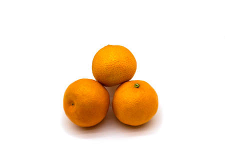 Three juicy mandarins close up isolated on a white background
