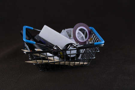 Shopping cart layout from a supermarket with a set of manicure tools close up on a dark background