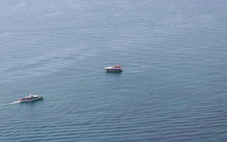 two boats in the open blue sea landscape
