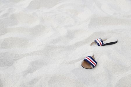 shoes on sand in summer