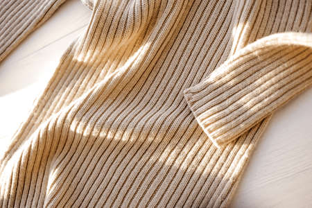 Knitted woolen dress, beige texture abstract fashion background, trend color