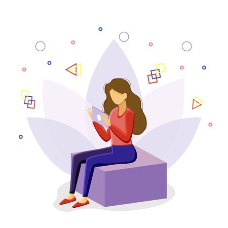 the girl is sitting on a cube with a tablet.