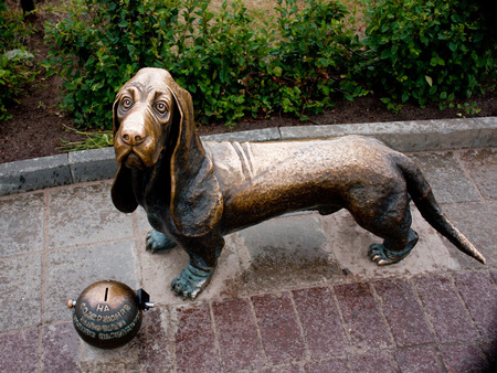 forlorn: Bronze monument of homeless pets. Basset Hound Stock Photo
