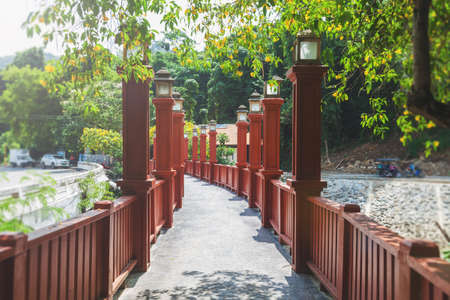The wooden red-painted bridge in Krabi, Thailand. Chinese style Red Bridge.