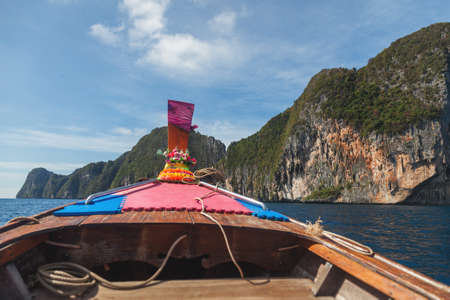 Summer, Travel, Vacation, Holiday concept. Beautiful landscape of rocks mountain and crystal clear sea with longtail boat Thailand.