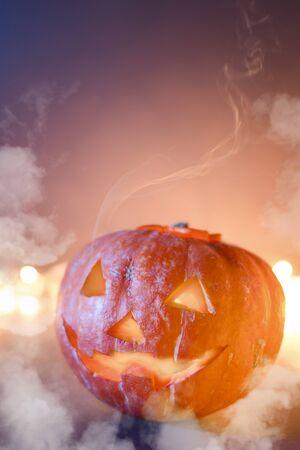 Symbol of halloween. Jack O Lantern Halloween pumpkins, burning candles Standard-Bild