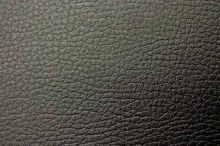 Black leather background texture. dark leather surface structure. animal skin, upholstery furniture