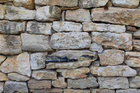 Limestone stone, masonry uneven pieces of sandstone, texture background backdrop. White yellow textured surface Imagens