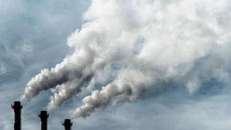 Toxic emissions of toxic gases into the atmosphere, industrial air pollution. Problems of the environment and ecology. Dark chimneys blowing huge billows of smoke into the sky