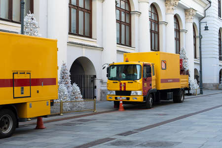 Moscow, Russia - January 26, 2020: Two emergency vehicles. City service for eliminating accidents, sewage blockages and gas leaks. Yellow red truck Redactioneel