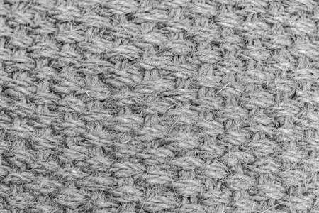 Texture of woven fabric of jute fibers, black-white textured backdrop effect background for design. Natural fiber, jute thread, weaving of rough burlap material for agriculture