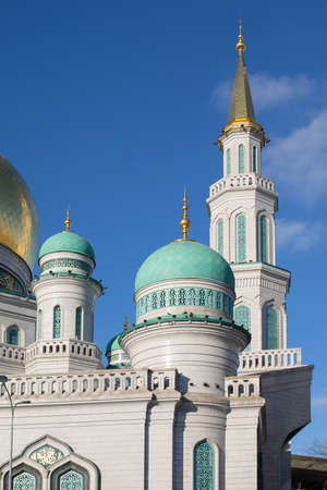 Golden Minaret Moscow Cathedral Mosque and blue domes. Islamic religious building