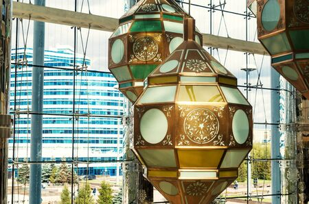 Kazakh style lanterns hanging from the ceiling in a shopping mall in Nursultan