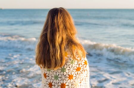 Anonymous woman enjoying silence and loneliss at the seaside Stock Photo
