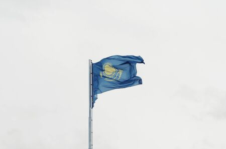 The kazakh flag on a windy day