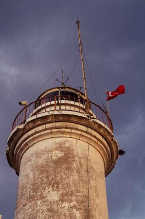 A Turkish flag winding on top of the Gelidoniya lighthouse on the Lycian Way in Antalya, Turkey.