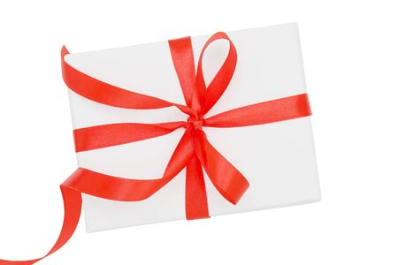 Wrapped gift box with red ribbon bow, isolated on white, top view