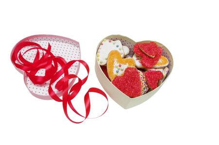 Cookies in the Shape of Heart Decorated with Ribbon at St Valentine's Day Isolated on White with clipping path,
