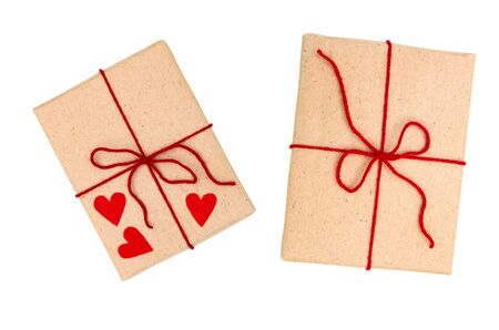 Two wrapped brown vintage gift boxes with red ribbon bow and heart, isolated on white, top view