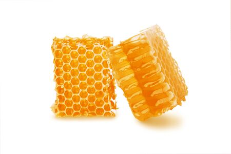 Honey in honeycomb two pieces isolated on white background, close-up Reklamní fotografie
