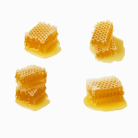 Isolated honey. Four honeycomb pieces isolated on white background, package design element.
